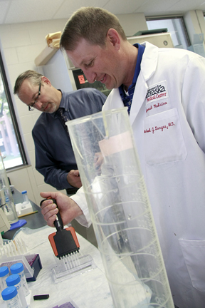 An interdisciplinary team of researchers at the University of Nebraska Medical Center in Omaha—Dan Anderson (left), Michael Duryee (right) and Geoff Thiele (not pictured)—believe they found a way to determine who will develop potentially deadly heart disease with a simple blood test.