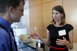 UNMC researcher Anna Brynskikh Boyum (right) chats with business partner Tom Frederick — an engineering doctorate candidate at UNL — during the 2013 UNMC Startup Company Demonstration Day reception in the Durham Research Center.