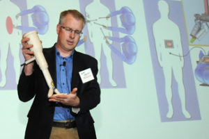 Shane Farritor, an engineer at UNL and co-founder of Virtual Incision, displays his new surgical device during UNeMed Corporation's inaugural UNMC Startup Company Demonstration Day Monday afternoon in Omaha.