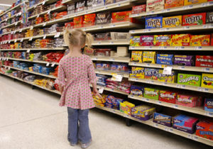 Until she discovered the candy aisle at the supermarket, Madeleine Litton, 3, had no idea such a bounty of sweet happiness could exist.