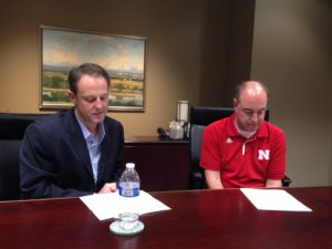 UNeMed President Michael Dixon (left) looks over his notes during his halftime interview with Greg Sharpe (right), which was broadcast Saturday night during Nebraska's 38-17 win over Northwestern.