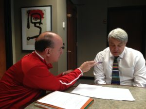 Greg Sharpe (left) and interim president of the University of Nebraska chat about the value of the University to the state during a pre-rocrded interview that aired during the Nebraska-Iowa football game last week.