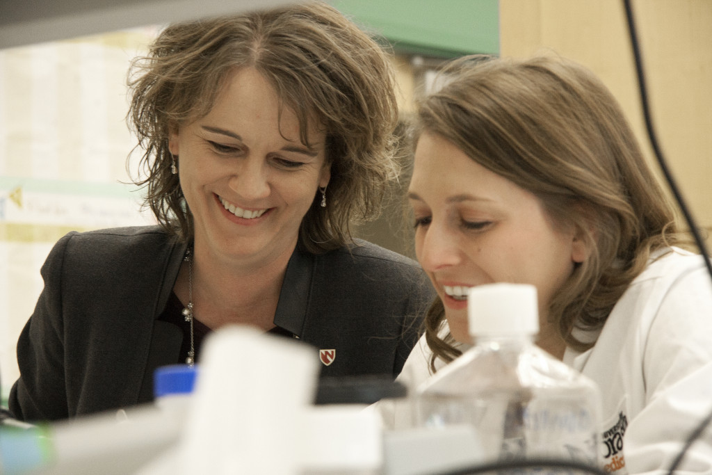 UNMC Professor of Pathology Tammy Kielian, Ph.D., (left)—seen here with doctoral student Megan Bosch—was named UNeMed's 2015 Innovator of the Year for her work against Juvenile Batten Disease and biofilm infections.