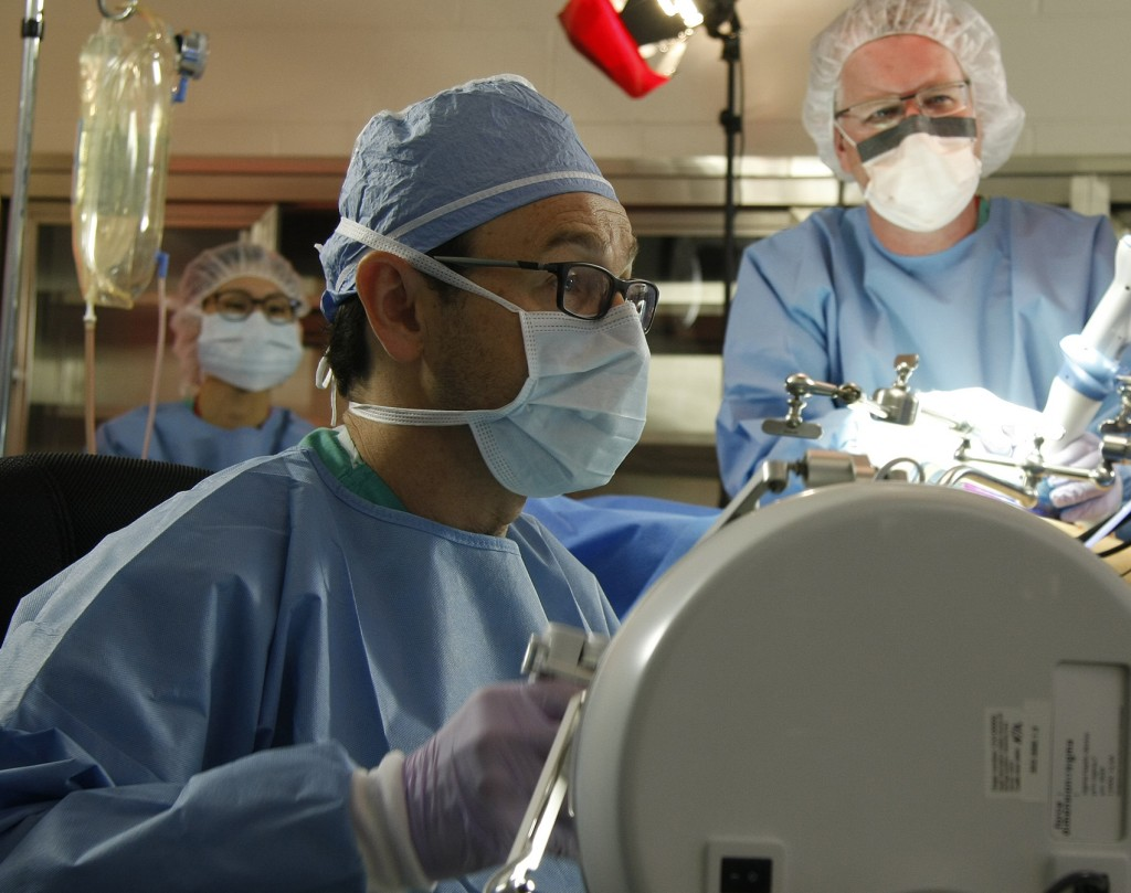 UNMC surgeon Dmitry Oleynikov (left) and UNL engineer Shane Farritor test a surgical robot prototype during a recent trial in Omaha. Their collaboration created a startup company, Virtual Incision, which hopes to make major surgery—like a bowel resection—a laparoscopic procedure.
