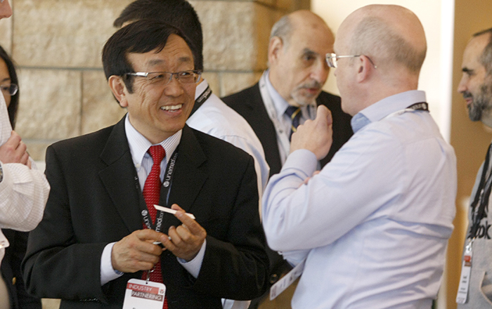 UNMC researcher Rongshi Li, Ph.D., meets with Niall O'Donnell, of the venture capital firm RiverVest, during UNeMed's 2016 Industry Partnering Summit held at UNMC's Michael F. Sorrell Center on May 10.