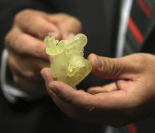 UNeMed's annual Innovation Week continued Oct. 4 with a panel discussion about the biomedical applications in healthcare. Above, R. Gabe Linke, the 3D printing coordinator at Children's Hospital and Medical Center in Omaha, shows guests a 3D-printed model of a newborn's heart. Surgeons used the model to study abnormalities, and planned an eventually successful procedure to correct the problems.